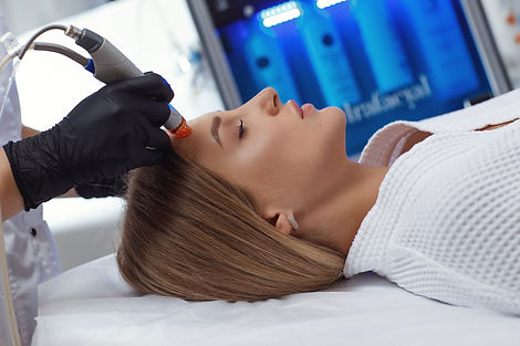 Side view of woman receiving microdermab