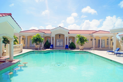 Bella Vista 10, Tierra del Sol with resort-style pool - the largest residential home pool on the island - and a pool bar, plus a fully equipped two (2) bedroom, one (1) bathroom pool view suite.