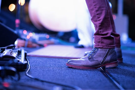 perfomer singer musician foot shoes on stage -  image found in Arise & Shine Arts and Entertainment (ASAE) Christian Community helping emerging artists and creatives by providing ministry, education and resources.