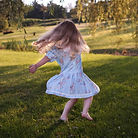 girl%20dancing%20on%20green%20grass%20fi
