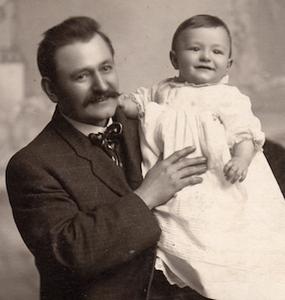 Father Alois holding son Robert