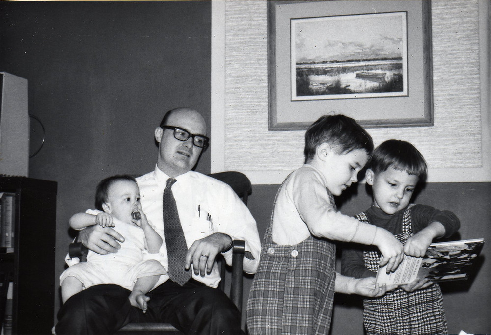 Rob with three young children