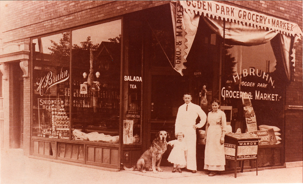 The Bruhn family, including William Tell, the dog outside their market