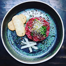 Steak tartare with honey and pear