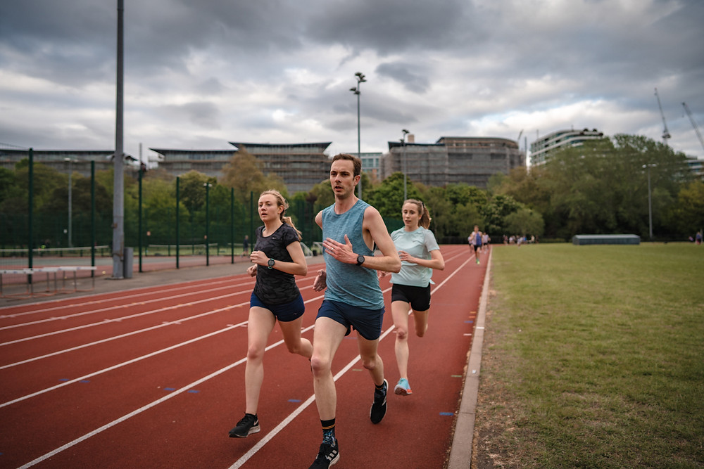 Lizzie Goldie-Scot, James Morris and Daniella Maggs of The Stable and Belgrave Harriers run a track session at the Battersea Park Millennium Arena