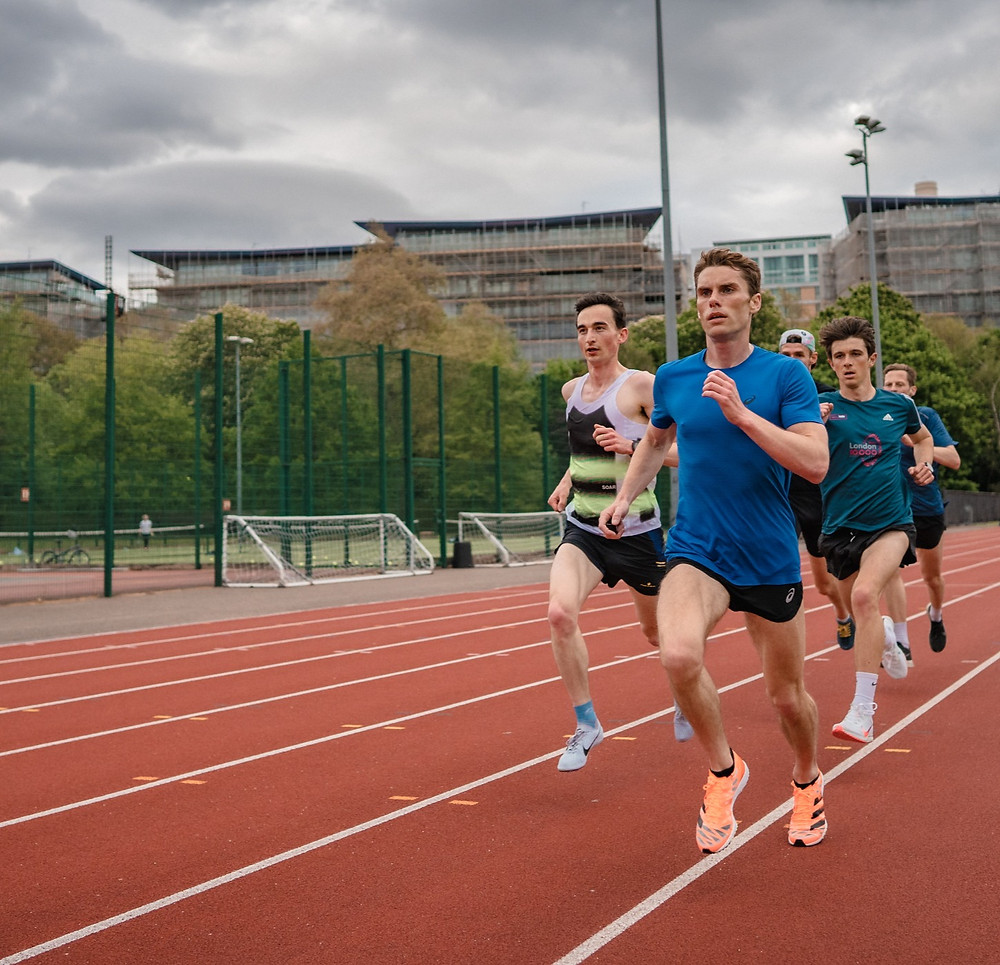 Coach Matt Welsh leads Callum Stewart, Brad Courtney-Pinn, Arne Dumez and Nick Buckle of The Stable and Belgrave Harriers through a track session