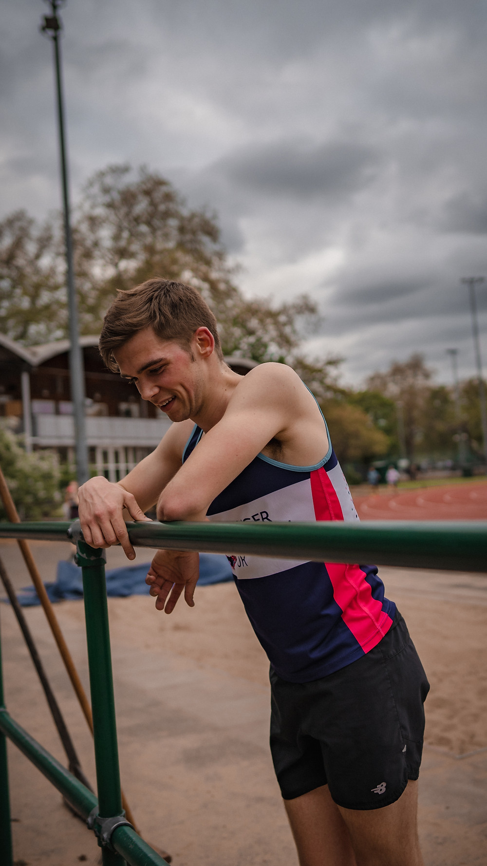Jim Rijks of The Stable and Belgrave Harriers rests after running a track session on the Battersea Park Millennium Arena track