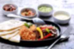 mexican beef fajitas served with rice, s