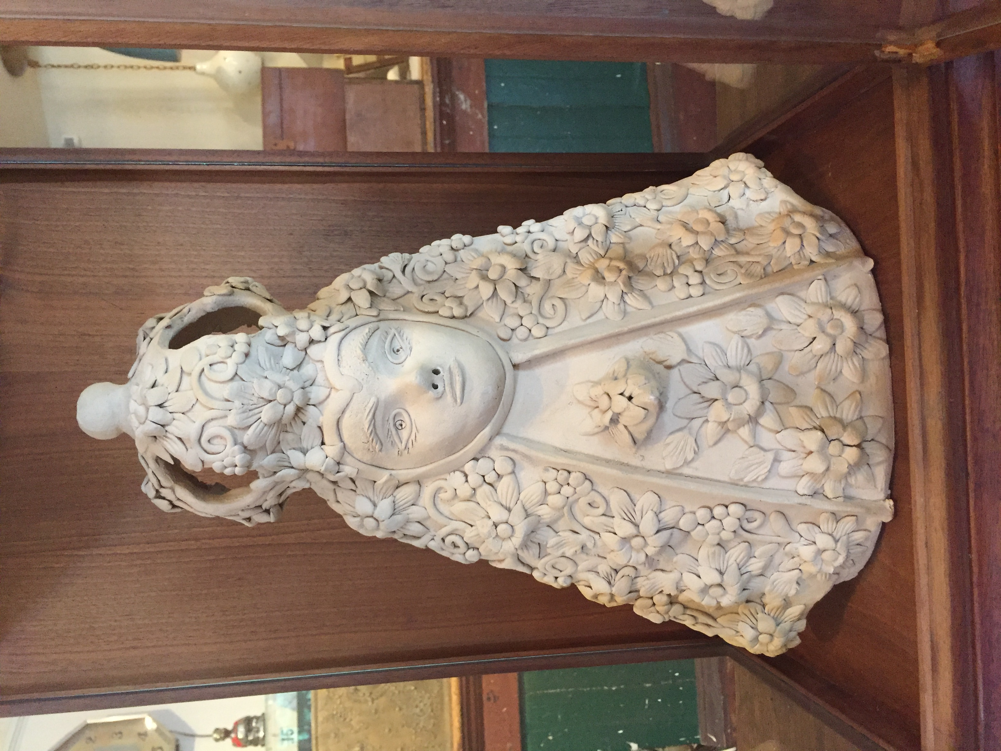 St. Theresa and Display Case