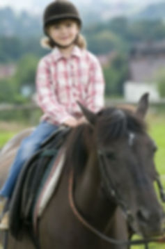 Youth riding horse