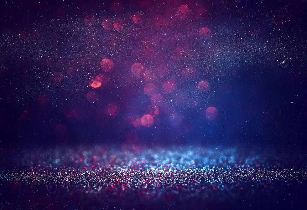 Red glitter vintage lights background..j