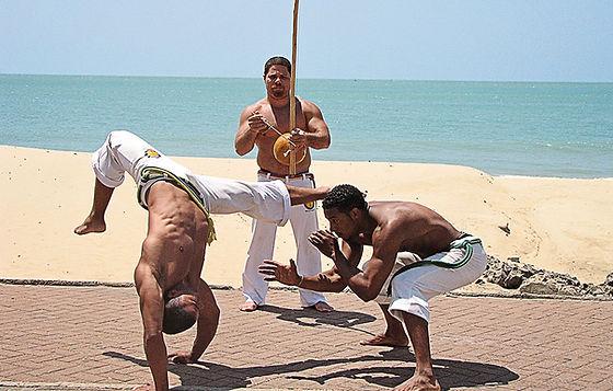 Lelo and Felipe and mestre on beach.jpg