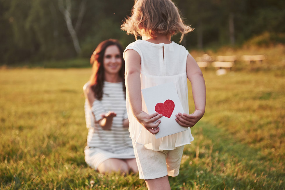child-s-daughter-congratulates-her-mothe
