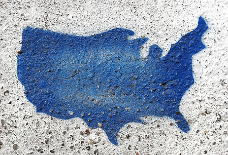 Painted outline of USA on rough cement.j