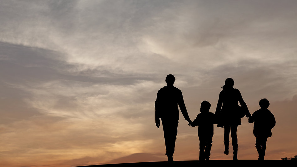 Silhouette of a family comprising a fath
