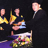 College Student Receiving Diploma