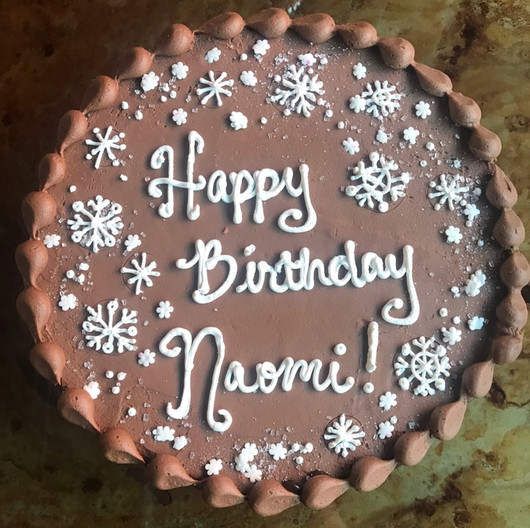 Personalized message chocolate cake with chocolate buttercream and shell border.