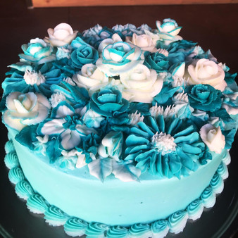 3 color full floral with shell border vanilla cake with vanilla buttercream frosting.