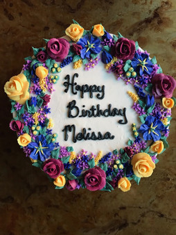 5 color full floral wreath with custom message vanilla cake with vanilla buttercream frosting.