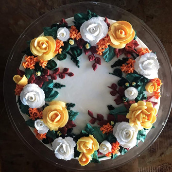 5 color full floral wreath vanilla cake with vanilla buttercream frosting.