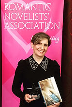 Aithor Kate Kerrigan wth her 2017 award from the Romantic Novelists Association.