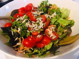 Simple salad with farm basket produce