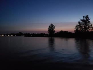 Distance swim, darkness and into rising mauve sunrise