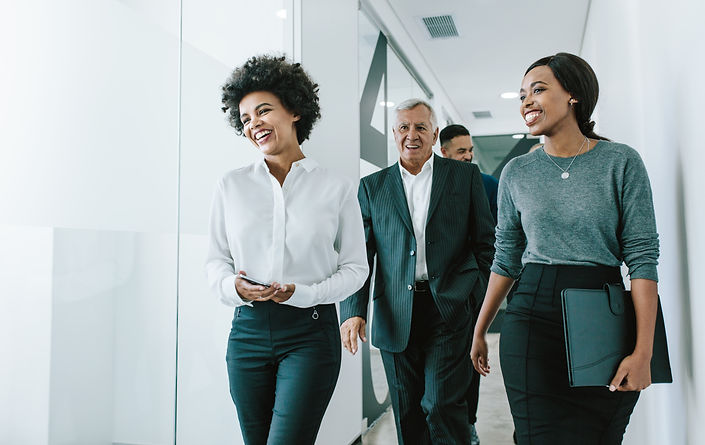 Diverse group of business people walking