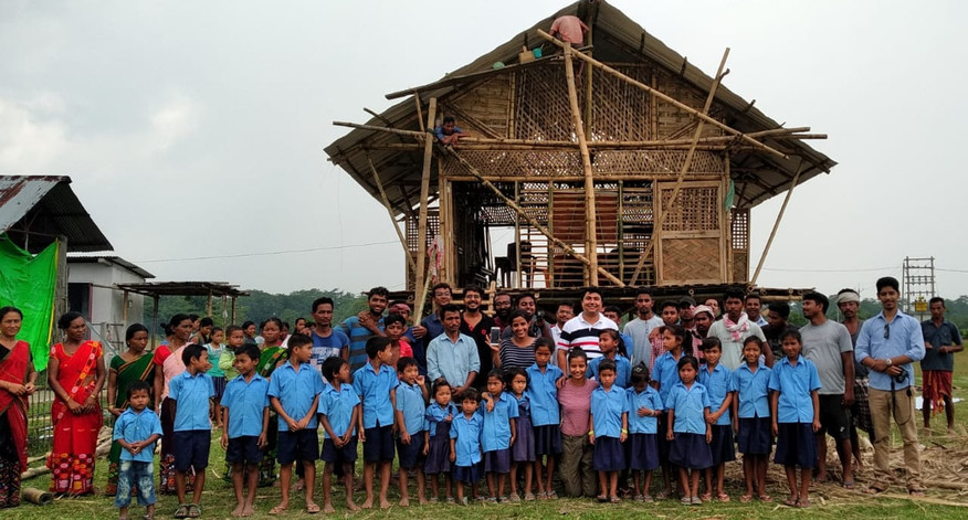 the team - the children, local craftsmen, officials, and architects