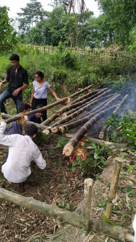Roasting the bamboo on site to prevent termites
