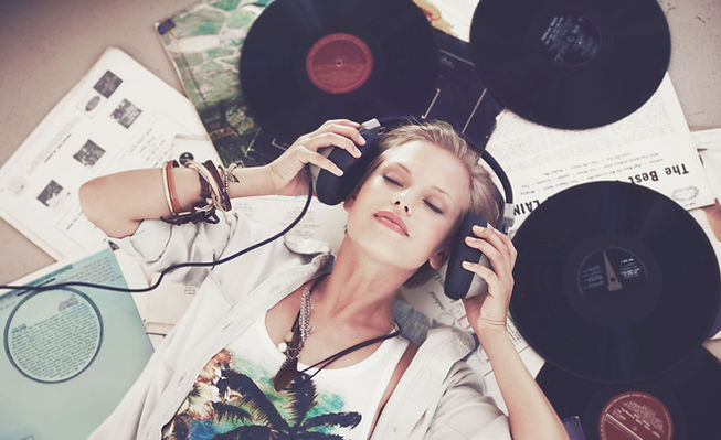 Woman Surrounded by Records
