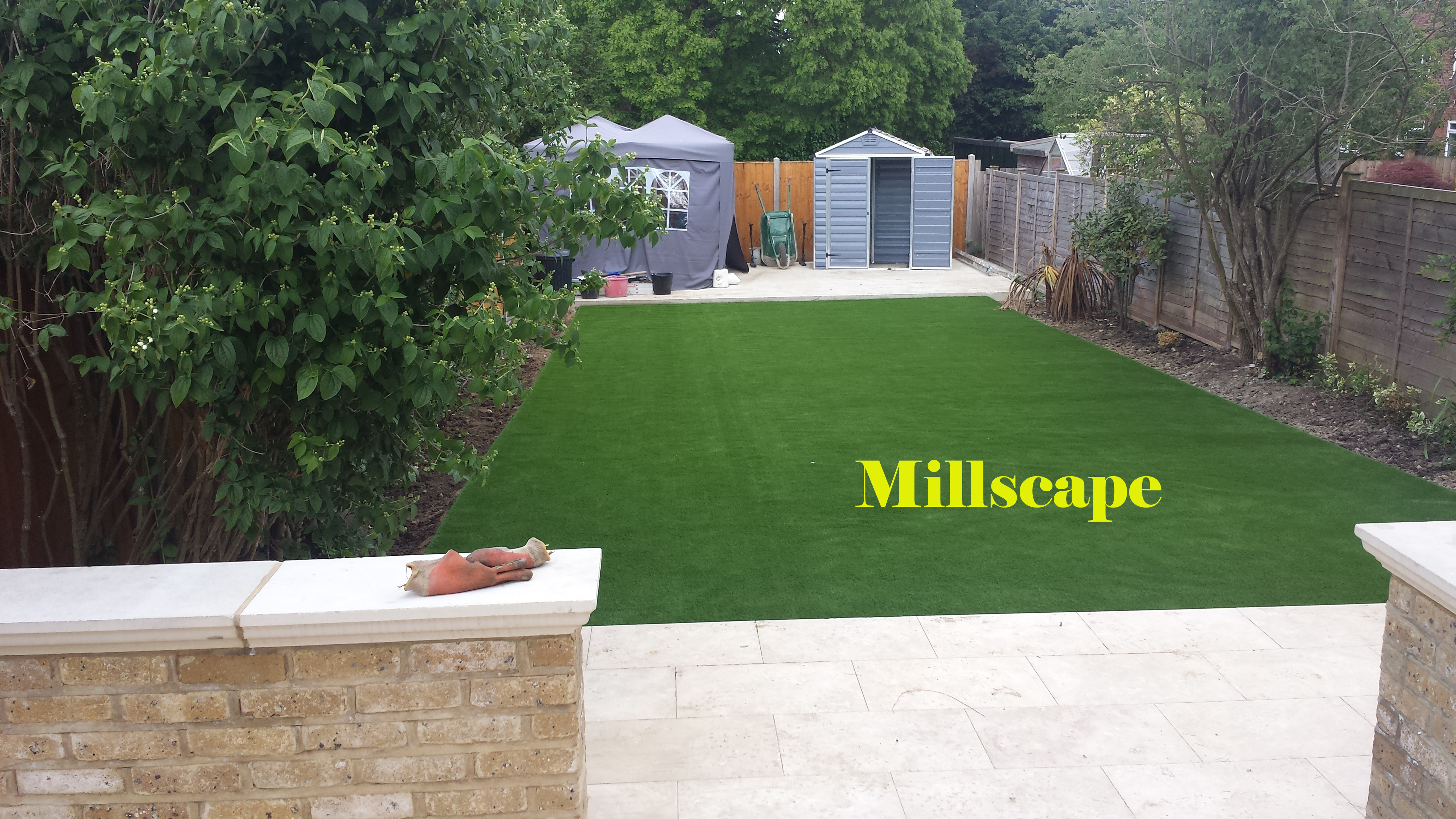Landscaping Laying artificial grass