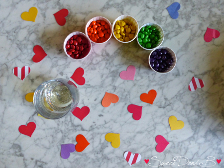 In the days before the party, big brother Donovan helped out by using a heart punch to make heart confetti in a rainbow of colors. We sprinkled the confetti everywhere.