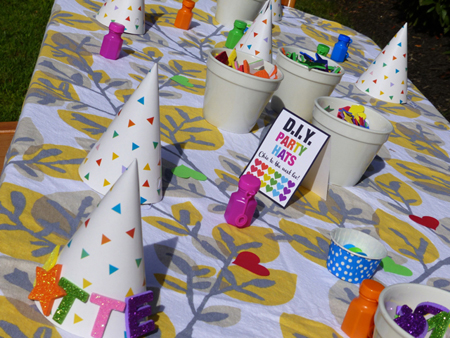 We set up 2 activities for the kids… the DIY party hat table featured blank hats with foam stickers, googly eyes and bubbles.