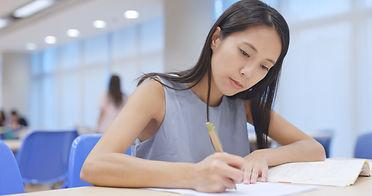 woman-study-at-university-library-QD6QL6