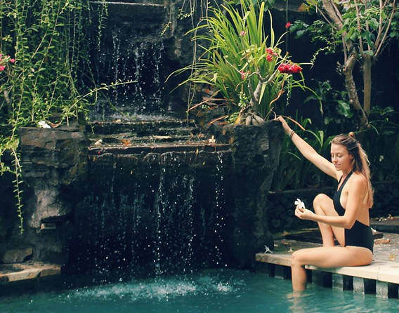 Yoga student at the pool in bali during yoga teacher training