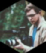 Film Hive filmmaker wedding videographer using camera in woodland