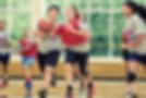 image of a girl dribbling  basketball