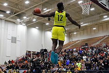 image of a strong black man slam dunking a basketball