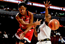 image of a young black woman passing a basketball
