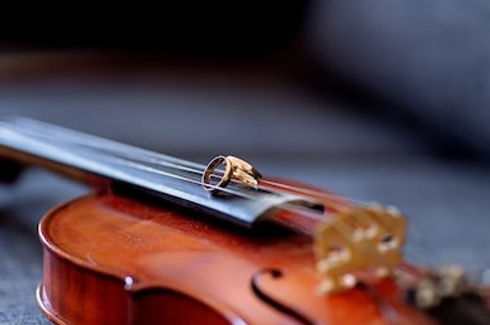 wedding-rings-on-violin-260nw-571051822_edited.jpg
