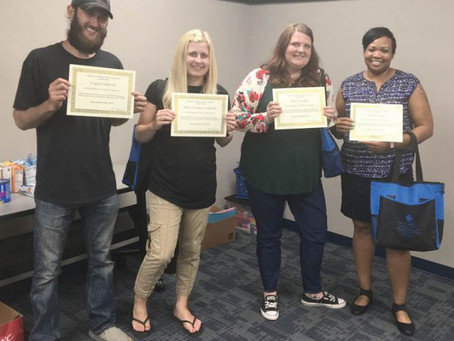 Four families graduate from foster parent classes