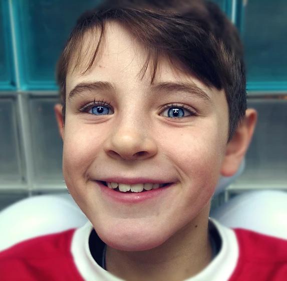 Young boy with prosthetic eye