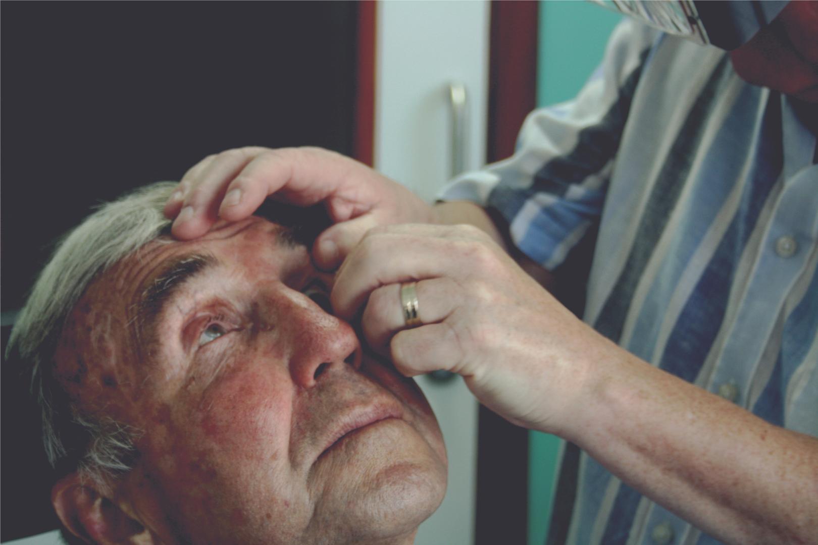 John treating an elderly gentleman