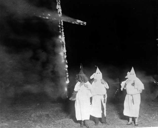 Ku_Klux_Klan_members_and_a_burning_cross