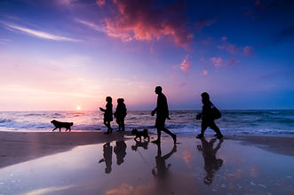 Family walk on the beach at sunset.jpg