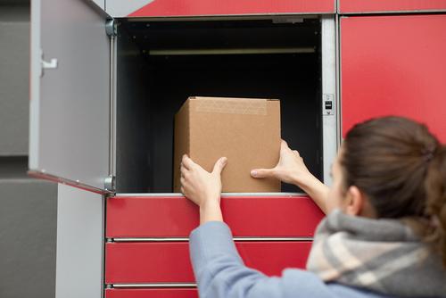 putting-parcel-into-parcel-delivery-locker