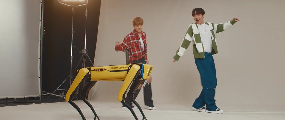 BTS dancing with a robot dog