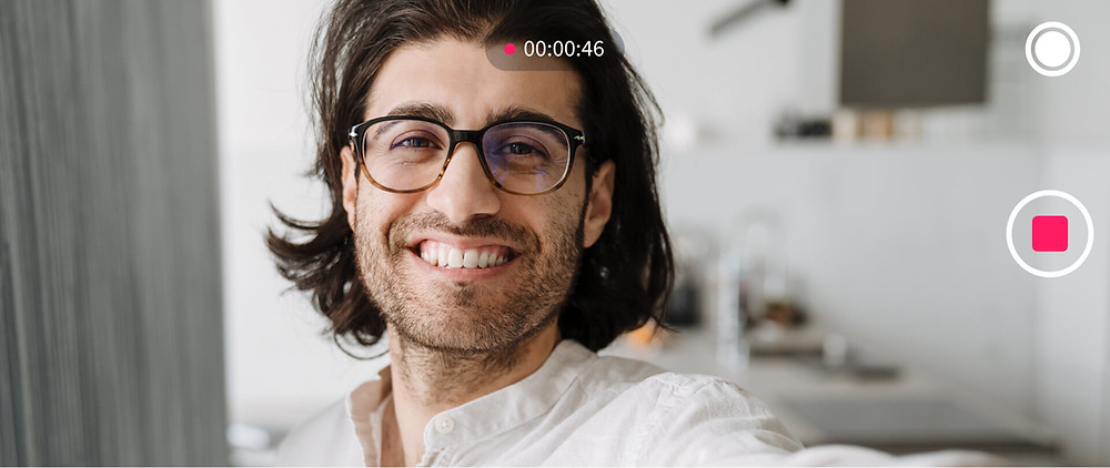 A man recording his video message for a VidDay birthday video gift