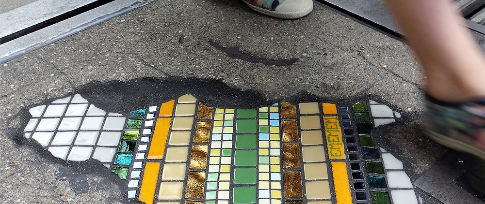 a pot hole filled with mosaic tiles